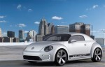 """The 2012 Beetle goes green with this electric version that can go 110 miles on a single charge. It's a little on the bigger side of """"mini,"""" but hey, it's still pretty adorable."""
